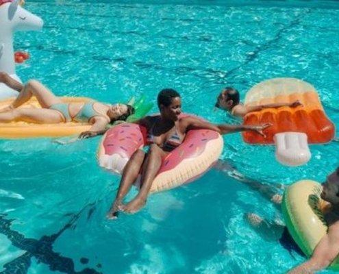 people floating in a pool on floaties